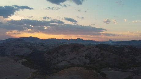 Aerial view of an arid landscape during sunset