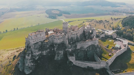 Aerial view of an old castle on top of a hill