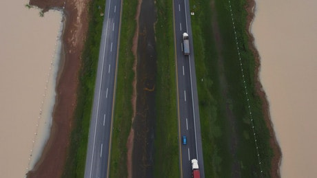 Aerial view of cars and trucks traveling on a highway
