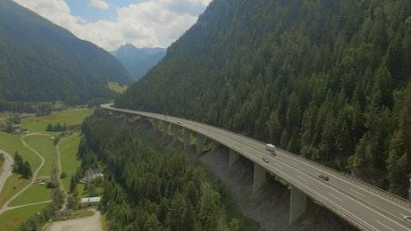 Aerial view of highway bridge along mountain ridge