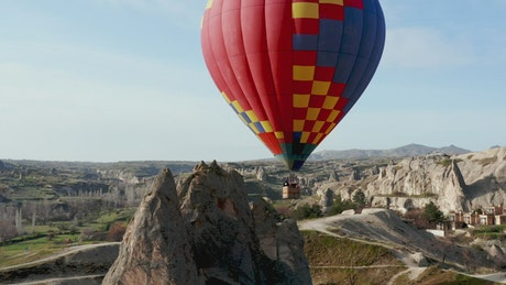 Aerial view of hot air balloon over Turkish landscape