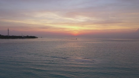 Aerial view of landscape of a calm sea at sunset