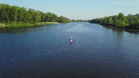 Aerial view of man on paddle board in river