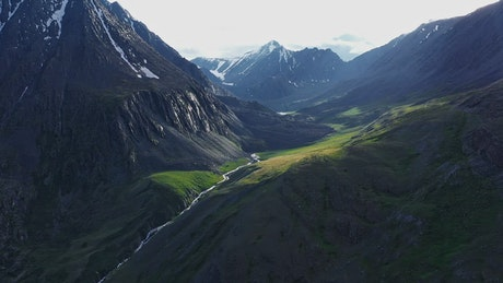 Aerial view of river through mountain pass