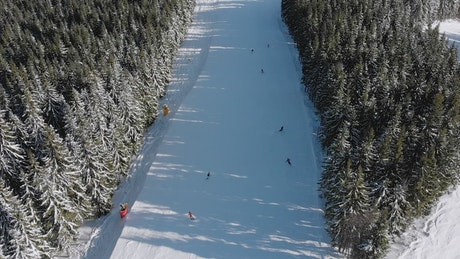 Aerial view of skiers going down the mountain