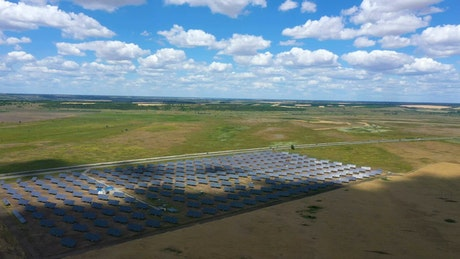 Aerial view of solar panels in a large field