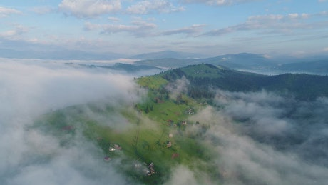 Aerial view of some clouds over a village