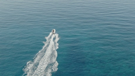 Aerial view of speed boat in sparkling sea