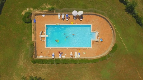 Aerial view of swimming pool in large garden
