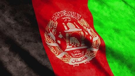 Afghanistan waving worn flag
