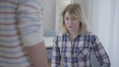 Afraid woman looks up at threatening man