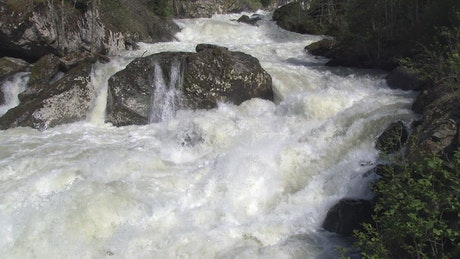 Agresive rapids in the river in slow motion