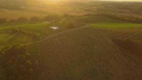 Agriculture fields and country house during sunset