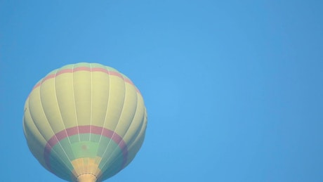 Air balloon rising in the clear sky