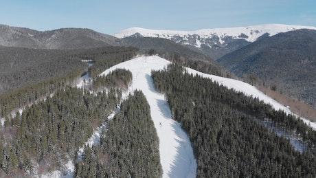 Air tour through a snowy mountain range