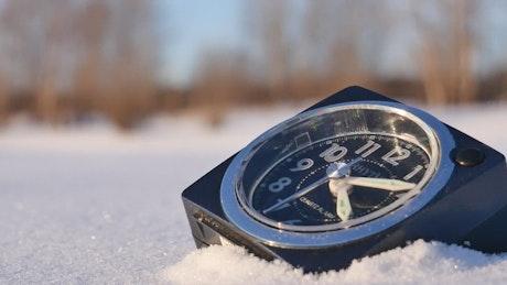 Alarm clock in the snow