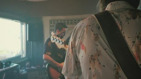 Amateur guitarists rehearsing