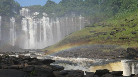 Amazing falls and river with a little rainbow
