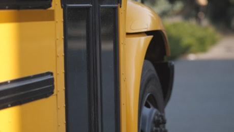 American children boarding a school bus