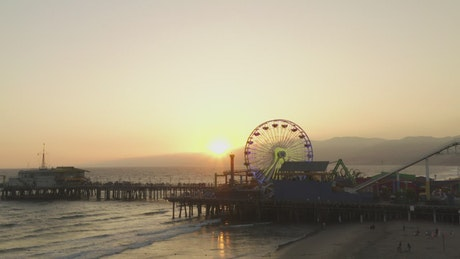 Amusement park by the sea at sunset