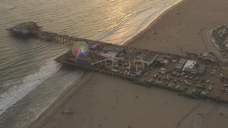 Amusement park on a pier on the seashore