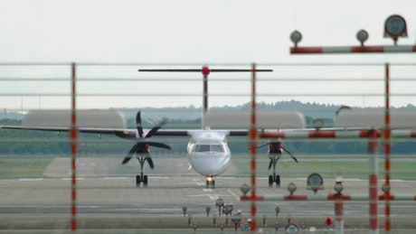 An airplane stopping at the airport