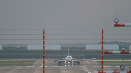 An airplane takes off in the airport