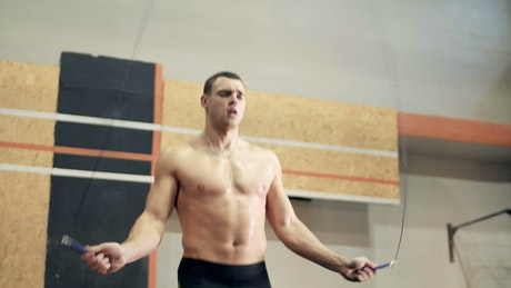 An athlete jumping the rope in the gym