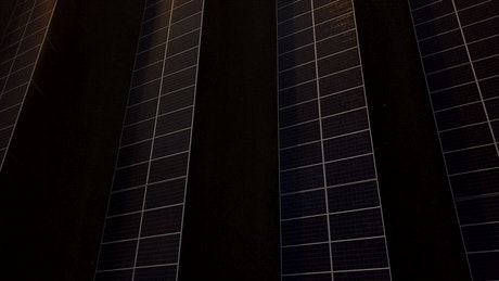 An industrial solar plant panels in the sunset