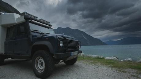 An off road camper van by the lake
