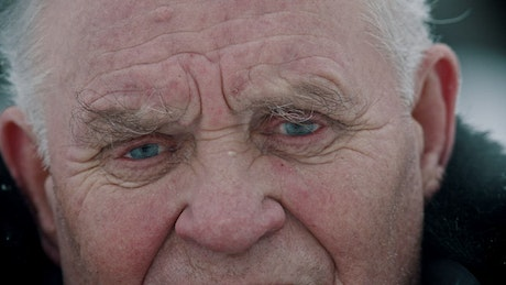 An old mans face with wrinkles