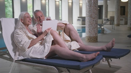 An older adult couple relaxing in a hotel