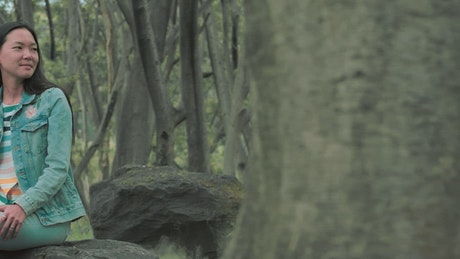 An urban trendy woman at a forest