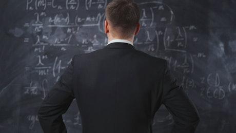 Analyzing equations written on a blackboard