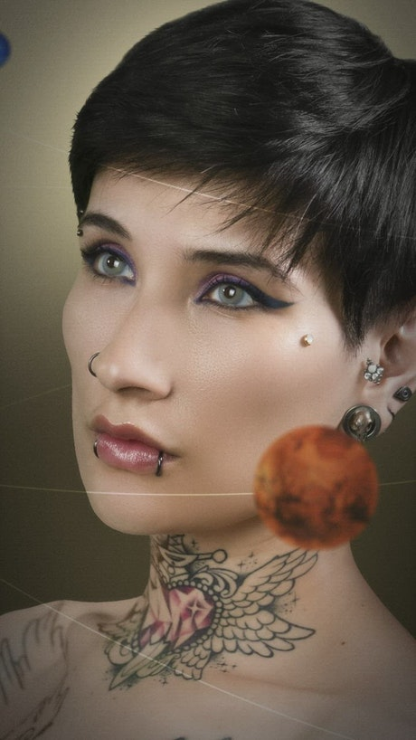 Animated photograph of planets orbiting a woman