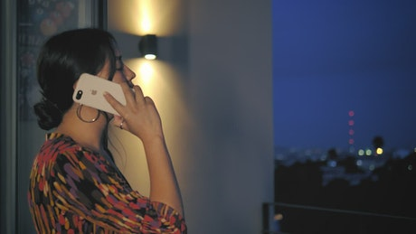 Annoyed woman talking on the phone
