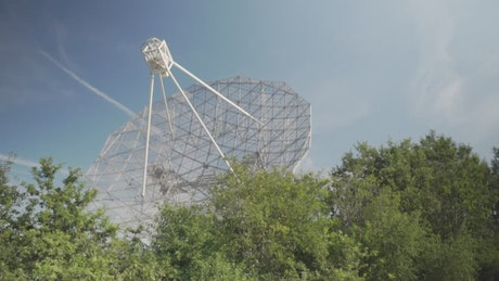 Antenna of a radio telescope pointing to the sky