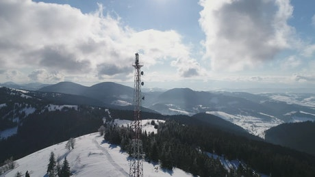 Antenna tower in a snowy mountain range