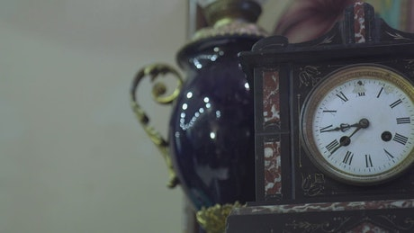 Antique clock against the wall