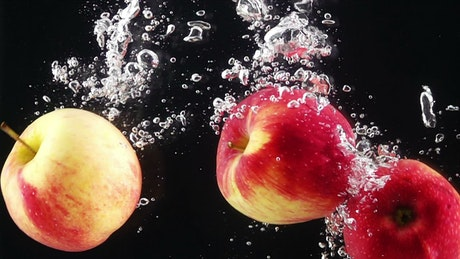 Apples falling through water
