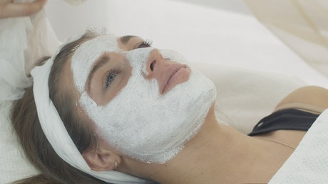 Applying a face mask in a Beauty Salon