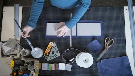Applying glue to handcraft in the studio