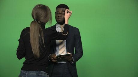 Applying make up to news presenter on chroma key