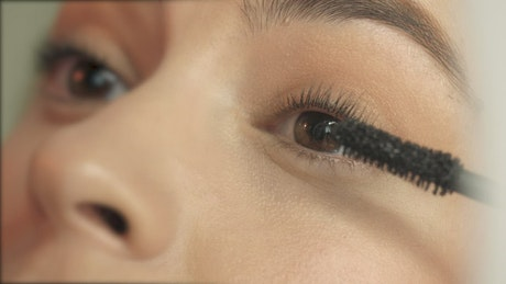 Applying mascara closeup