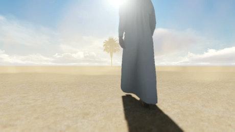 Arab walking on a sandy desert