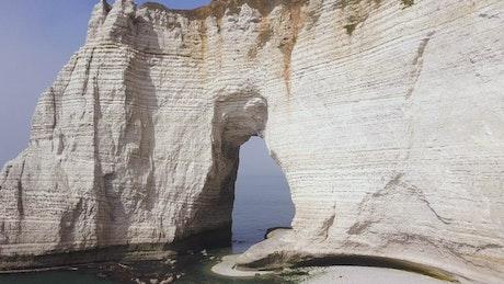 Arch under a coastal cliff