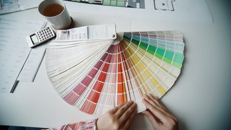 Architect choosing a color from the color plate