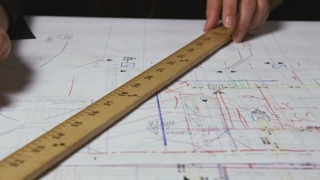 Architect drawing lines on a document