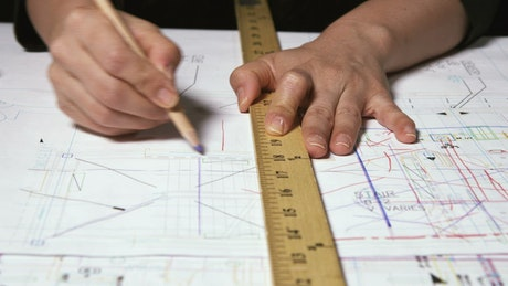 Architect drawing with a ruler
