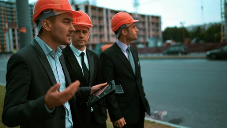 Architect talking to businessmen